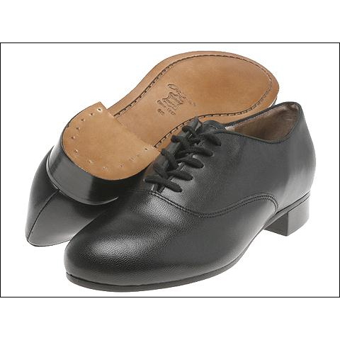 "Capezio Pro.Character Tap Oxford Style #: K360. The Character Tap Oxford is renowned throughout the world as the shoe of choice for professional tap dancers. Our highly skilled SMU department developed this exceptional design, incorporating components that create great sound and provide comfort and flexibility. The high quality, full-grain leather gives this shoe flexibility for toe stands and has a 3/4"" stacked leather heel that enhances the sound when tapping. Available in classic Oxford design (Shown),or old-fashioned Wing Tip Design (Wing Tip design available in Black/White and White/Tan combo through special order at the price of $359.95 we suggest calling in your order). Taps not included. Narrow widths available in Black color only.***Build-Up Are Final Sale***