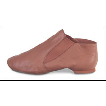 Capezio - Split Sole,Slip on Jazz Boot Style #: CG05C. This jazz boot from Capezio® hugs the foot with comfortable elastic instead of laces. The fit is smooth and secure, producing an unbroken line. Soft, supple leather and split-sole construction create great flexibility and a beautiful arch.